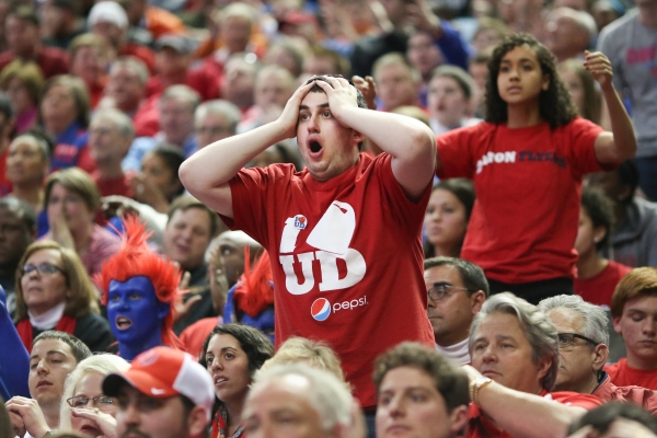 A fan of the Dayton Flyers reacts to a play during the third round of the 2014 NCAA Men's Basketball Championships against the Syracuse Orange at the First Niagara Center on Saturday, March 22, 2014 in Buffalo, N.Y. The lead changed four times in the last 10 minutes of regulation before the Flyers upset the Orange 55-53. Photo By Josh Barber