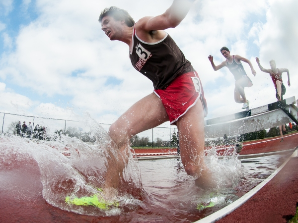 Aaron Tompkins of the Saint Lawrence Saints competes in the men's 3,000-meter steeplechase during the 2014 Liberty League Track and Field Championship at Tiger Stadium on Saturday, April 19, 2014 in Henrietta, N.Y. (Josh Barber/RIT SportsZone)