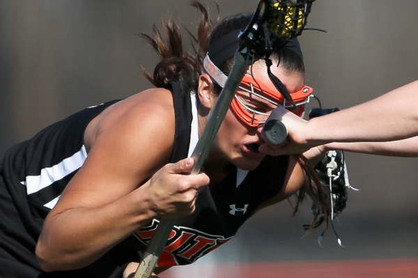 Ashleigh Caruso gets a hit to face during a game against the RPI Engineers at the RIT Turf Field on Friday, April 11, 2014 in Henrietta, N.Y. (Josh Barber/RIT Sports Information)
