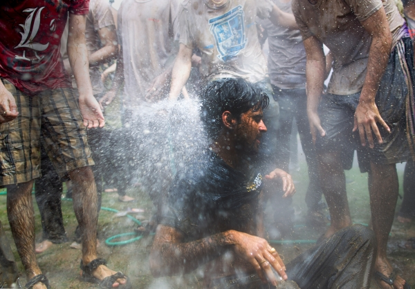 Rochester Institute of Technology student Sachin Gawande (cq) gets soaked by a garden hose during the Indian Holi Festival of Color on April 26, 2014 in Henrietta, New York.