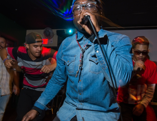 JBain DaStar (Center), of Rochester, NY, performs with group members Ricardo Murray (Left), of Rochester, NY, and Marcus Montreal (Right), of Rochester, NY, at the Thirsty Frog, in Irondequoit, NY, on April 28, 2014.  They are members of New Tren Gang, an aspiring hip-hop group founded in Rochester, NY, and this was their second live performance. Photo by David Falconieri