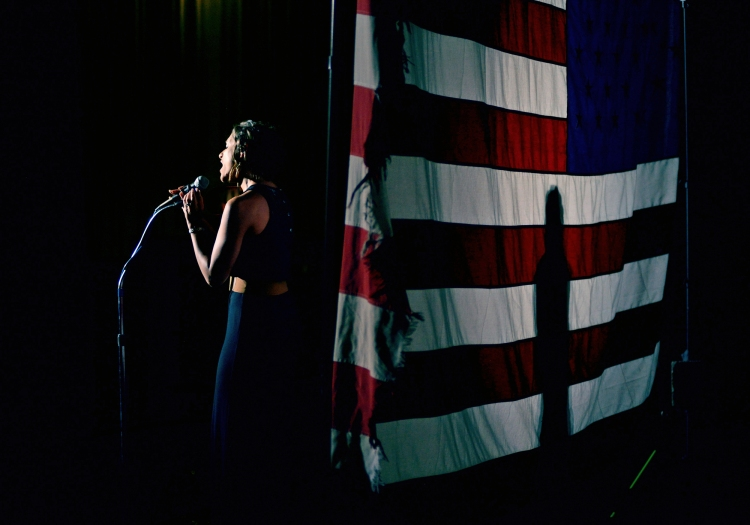 "Kayti Stadler, 28, lead vocalist with Key West Express and Lucky Dog, sings ""The Star-Spangled Banner"" at the Erie Playhouse in Erie, Pa., on June 26, 2014."