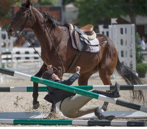 "Marilyn McKenny is thrown from her horse, ""Galeton Bay"", over the third jump of a triple line combination during her trip on course in the Low Adult Jumper division at the Devon Fall Classic in Devon, P.A., on Sept. 12, 2014. McKenny was immediately disqualified from the competition after her fall."