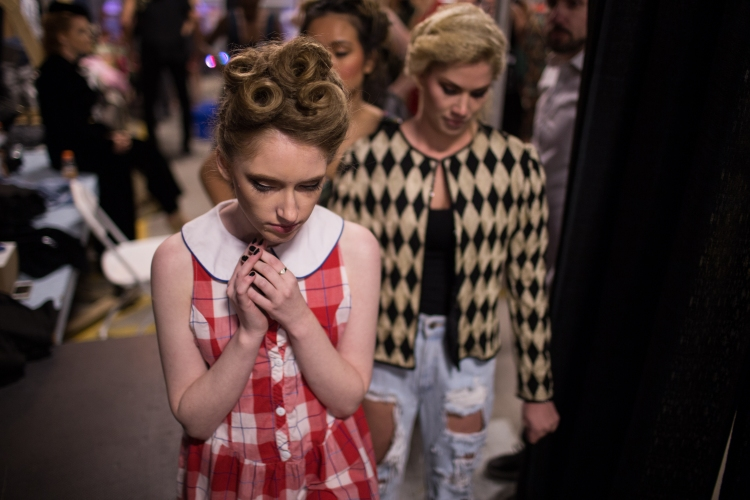 Maris Breaton waits for her turn to model in the From the Ground Fashion Show, on September 12, 2014 in Highland Falls Garage in Rocheste, N.Y.