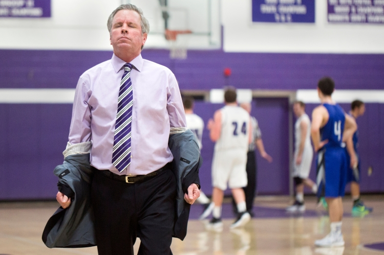 Rumson- Fair Haven regional high school Boy's Varsity head coach Chris Champeau pulls his jacket off in frustration after Jackson Reid #24, right, missed a foul shot that would tie the game, on January 6, 2015, in Rumson, N.J.