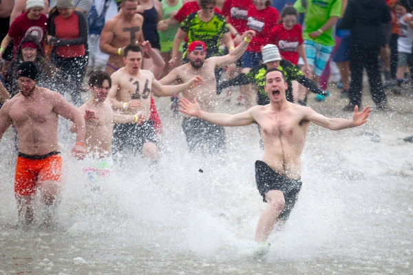 Plungers jump into the icy water during the Rochester Polar Bear Plunge at Charlotte Beach in Rochester, New York on February 8, 2015.  Hundreds attended the event to raise money for the Special Olympics.