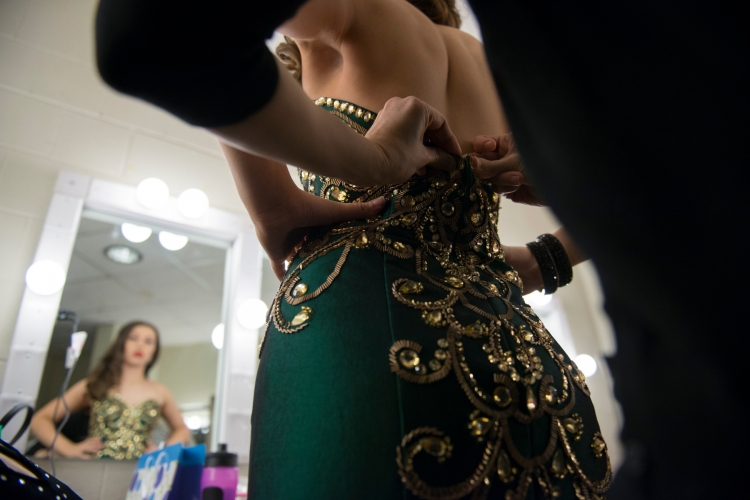 Marivi Howell-Arza gets zipped into her dress at the Miss Flower City Beauty Pageant. A pageant that is a preliminary round for the young woman to become Miss New York and then hopefully Miss America on January 31, 2015.