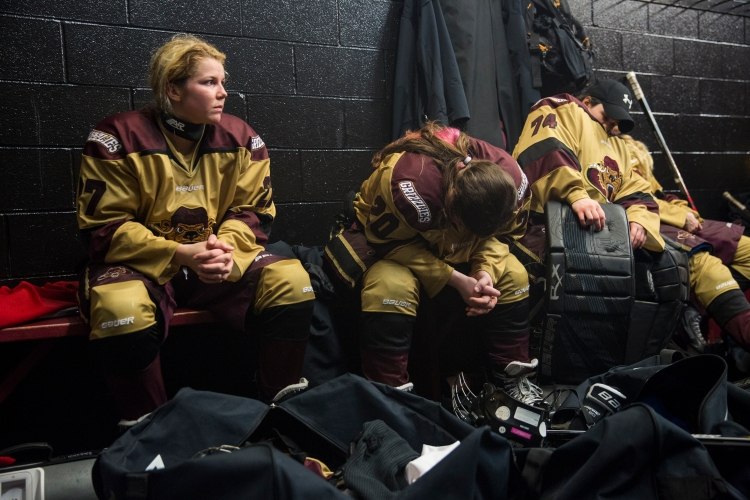 (From left) Shanley and her teammates, Lexi Firkins and Serena Angelo rest during half time after the second period of their first game against Troy-Albany on March 6, 2015. The Rochester Grizzlies were losing 0-1 at the end of the second period and came back to win the game 2-1 in a shootout.