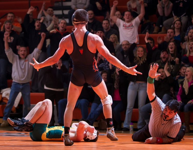 Brad Mayville, Rochester Institute of Technology, celebrates after winning the 149 pound bout by pin during senior night at RIT on Jan. 28, 2015. Mayville is a senior.