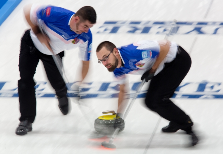Martin Snitil and Jindrich Kitzberger sweep a stone down the ice at the  Le Gruyre European Curling Championships on 11/22/2014. The Czech Republic ended up in 5th place after losing a tie break game to Norway.