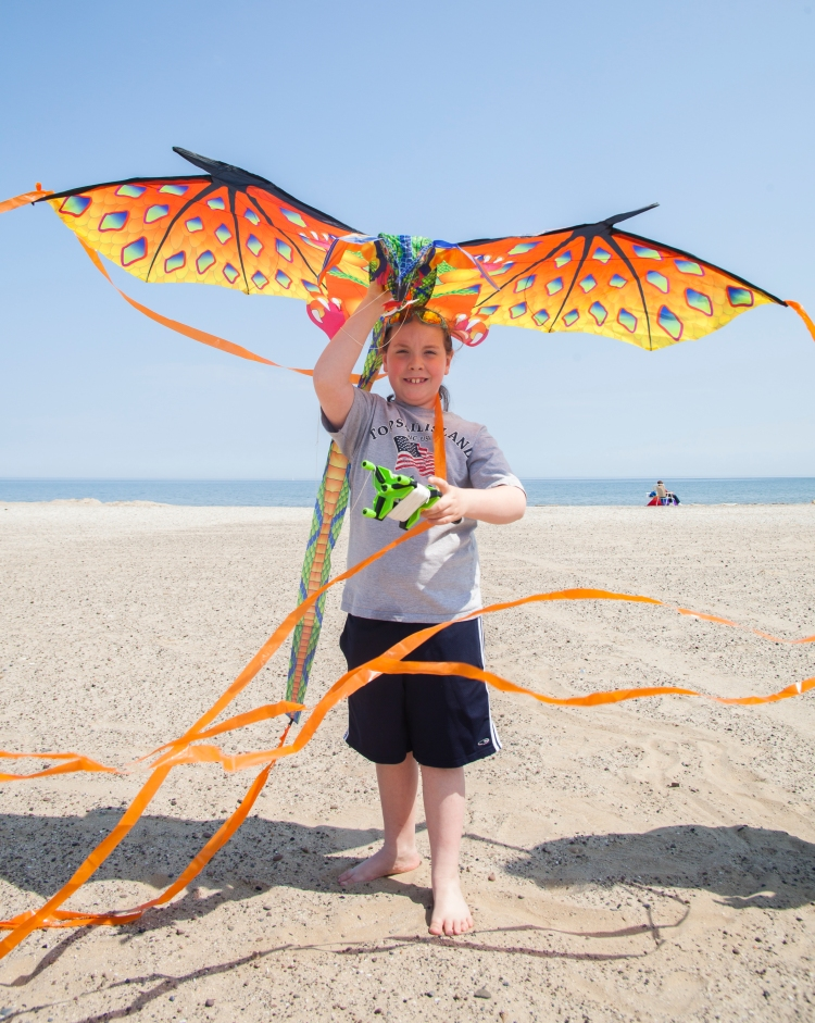 "Ocean Hodziewich, 8, of Dansville, NY poses for a portrait with his dragon kite at Ontario Beach Park in Rochester, NY on Sunday, May 3, 2015. ""They're fun to fly...I think I was 3 or 4 when I started."""