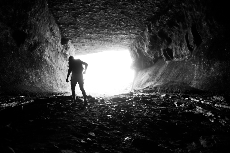 An RIT student explores a cave near Lower Falls in Rochester, NY.