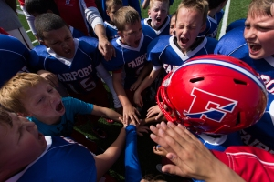 The Fairport Packers C team celebrate after defeating the East Rochester Bombers 13-12 in a football game at Don Quinn Field in East Rochester, N.Y. on Sept. 27, 2015.