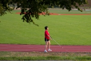 Lisa Lin walks the track at the Maryland School for the Blind on June 30, 2015 in Baltimore, Md.