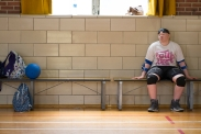 Tori Rice, 15, takes a break from playing Goalball. Goalball is a Paralympic sport designed for the visually impaired. Bells inside the balls help orient the players, indicating the direction of the on-coming ball.