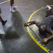 Jason Ryan, right, lays on the ground after losing a game of tug-of-war inside the Maryland School for the Blind on June 30, 2015 at Camp Abilities in Baltimore, Md.