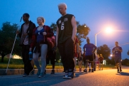 Attendees walk across campus to attend a bonfire at Camp Abilities, hosted by the Maryland School for the Blind on June 30, 2015 in Baltimore, Md.