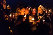The First Congregational Church holds a candlelight vigil in remembrance of the Kalamazoo mass shooting victims on Monday, Feb. 22, 2016 in Kalamazoo, Mich. Jason Dalton is accused of shooting eight people, killing six of them, in a random shooting spree in Kalamazoo.