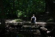 Tyler Rinallo rests on a bridge at his favorite hiking spot on June 22, 2015 in West Irondequoit, N.Y. Tyler described this location as his peaceful place where he can just be himself.