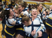 (From L-R) Maddie Holmes, Chrissy Hops, Schuyler Westfall, Robin Rider, and Camryn Burrel of Victor High School's varsity cheerleading team celebrate after winning best in their division on Feb. 13, 2016 at a competition held at Pittsford-Mendon High School. The team also won best overall performance of the day.