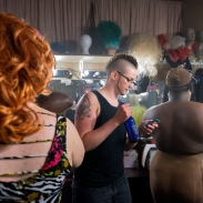 "Summary: Newlyweds, Tyler and Jessica Rinallo, experience many of the same challenges other couples face as they adjust to married life together. In addition to the simple changes, their lives are transforming in more complex ways as Tyler transitions from being a female to a male. Tyler Rinallo in the Tilt Nightclub dressing room with two drag queens before his performance on April 9, 2015. Most of the drag kings and queens perform twice a night interacting with the crowd while lip-syncing and dancing to music, ""When I first started performing I was a very shy person and by performing on stage it has allowed me to break out of my shell,"" said Tyler."