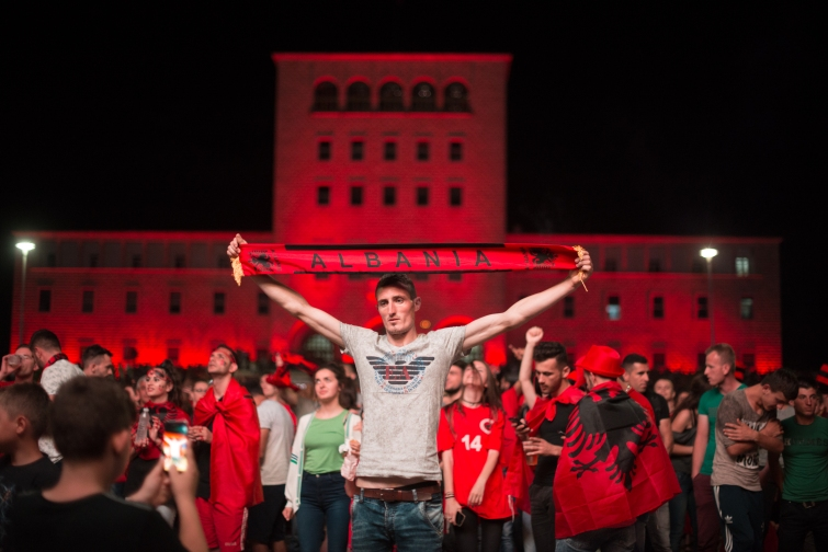 Albanian soccer fans celebrate after their country won the Group A match against Romania in Tirana, Albania on Sunday June 19, 2016. Albania defeated Romania 1-0.