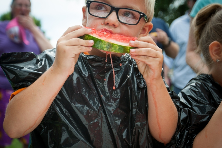 Ed Skarlem, 7, devours his watermelon piece in the watermelon-eating contest held in Larimore, N.D. as part of the Larimore Days celebration on July 16, 2016.