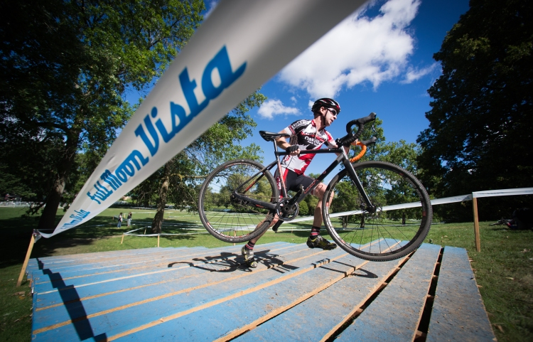 Mark Stuart climbs up the stairs at the Rochester Cyclocross course at Genesee Valley Park in Rochester, N.Y. on Sept. 11, 2016. Stuart placed first in his division.