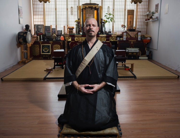 Cody Kroll, a Buddhist priest, poses for a portrait in the Enkyoji Buddhist Temple, located in the Hungerford building, in Rochester, N.Y., on Sept. 18, 2016. As a Buddhist priest, Kroll assumes the name and tittle Shami Kanyu Kroll while leading services, and teaching the dharma at the Enkyoji Buddhist Temple. During the day Kroll also works as a high school photography teacher.