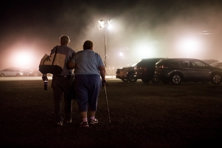 "Paul and Susan Kucera, both 75, of Binghamton, N.Y. walk back to their car after spending the day together at the Great New York State Fair, on the New York State Fairgrounds, in Syracuse, N.Y. on Aug. 29, 2016. ÒWe try to come every year"" said Mrs. Kucera, ""We have been coming since the fair [re]opened after World War TwoÓ. The fair grounds were used as a military base until the war ended, and the fair reopened in 1948. The Great New York State Fair is the largest annual event in New York State, this year attracting just over one million visitors during its 12 days running."
