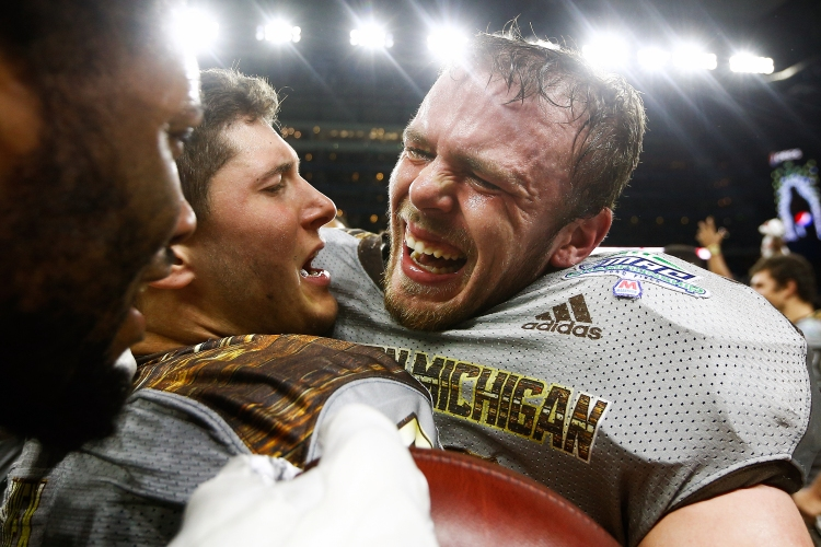 Western Michigan linebacker Robert Spillane (10) is greeted by teammates after a game winning interception  during the second half of the NCAA college football Mid-American Conference championship game against Ohio at Ford Field in Detroit, Friday, Dec. 2, 2016. WMU defeated Ohio 29-23 and is 13-0 on the season.