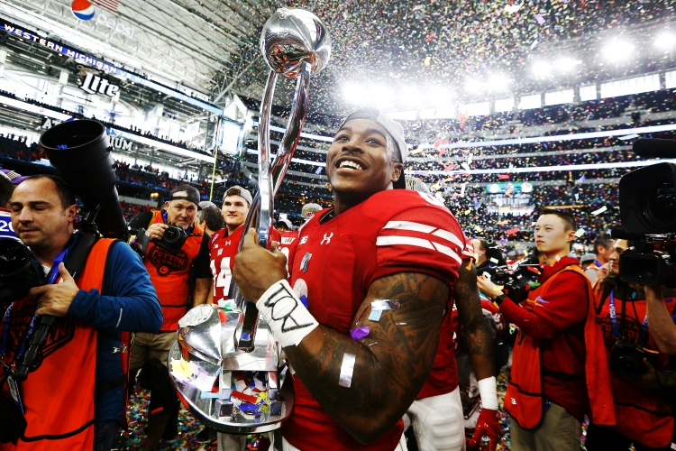Wisconsin Badgers running back Corey Clement (6) holds the Cotton Bowl trophy after defeating Western Michigan 24-16 in the 81st Annual Goodyear Cotton Bowl Classic between Western Michigan and Wisconsin at AT&T Stadium in Arlington, TX on January 2, 2017.