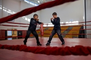 "(Boxing Brothers - 1 - Boxing gave Jay'von and Fynest Cummings energy and vitality, despite the obvious harm it caused to others and themselves. Jay'Von Cummings, 10, and Fynest Cummings, 8, are brothers who have attended classes at Future Boxing Club in Rochester, N.Y. since Feb. of 2014. Their father, Larry Cummings, 32, coaches his son's in their makeshift gym in their basement and cuts their hair before their big matches. Jay'Von and Fynest both look up to each other for help in both school, growing up and boxing. Jay'Von placed second in 2015 at the Silver Gloves and hopes to place first this Saturday and Sunday, Dec. 3 & 4. This year will be Fynest's first time entering the Silver Gloves.) Fynest Cummings, 8, (left) and Jay'Von Cummings, 10, (right) practice in the ring before the N.Y. State Silver Gloves Boxing Tournament at Wilson Foundation High School begins in Rochester, N.Y., on Dec. 4, 2016. ""His strengths are my weaknesses, we are always learning from one another,"" says Jay'Von."