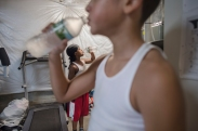 Jay'Von Cummings, 10, (front), and Fynest Cummings, 8, take a water break during their daily morning workout before school begins in their makeshift gym located in the basement of their home on Dec. 1, 2016 in Rochester, N.Y.
