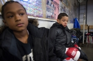 Fynest Cummings, 8, (left) and Jay'Von Cummings, 10 (right), watch the remaining matches at the West Area Athletic and Education Center in Syracuse, N.Y. on Dec. 10, 2016.