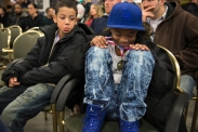 Jay'Von Cummings, 10, (left) reacts to Fynest Cummings, 8, (right) medal after Fynest won this bout at the West Area Athletic and Education Center in Syracuse, N.Y., on Dec.10 2016. Jay'Von lost this bout resulting in disqualification in continuing to the next round for the remaining year.