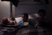 Nunu, center, is put to bed with his sister and brother at their home in Batavia, N.Y., Dec. 11, 2016.